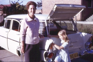 Mum and Helen with car at Lidcombe 1962